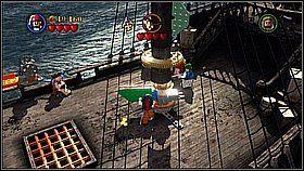Zanosimy skrzynię na zielone pole, a później składamy klocki - Czarna Perła atakuje - opis przejścia - Klątwa Czarnej Perły - LEGO Piraci z Karaibów - poradnik do gry