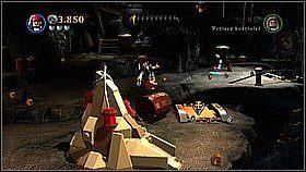 Wchodzimy do podziemi rozwalając kłódkę przy uprzednio odkrytym włazie koło drzewa z bananami - Nora przemytników - opis przejścia - Klątwa Czarnej Perły - LEGO Piraci z Karaibów - poradnik do gry