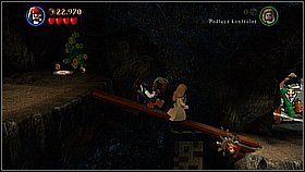 Biegniemy w lewo i jeszcze raz składamy z klocków pewien obiekt - tym razem wąski most - Nora przemytników - opis przejścia - Klątwa Czarnej Perły - LEGO Piraci z Karaibów - poradnik do gry