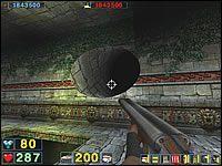 Sekret #14: Zaraz na początku korytarza z silnymi powiewami wiatru (dziury w podłodze z kolcami na dole) wejdź do tuneliku w ścianie po prawej stronie - Misja 3: The City of the Gods - Serious Sam: Drugie Starcie - poradnik do gry