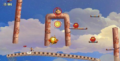 Przed drzwiami z okiem, znajdziesz Żalumek pod mostem, który zniszcz - Podniebna sonata (300 L, 2:50); Bez odwrotu (175 L) - Pustynia Dijirdów - Rayman Origins - poradnik do gry