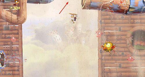 Po przejściu przez drzwi z okiem skocz z atakiem na bęben, odbijaj się od ścian, a dotrzesz do M - Wiatr albo przewóz (300 L, 2:20) - Pustynia Dijirdów - Rayman Origins - poradnik do gry