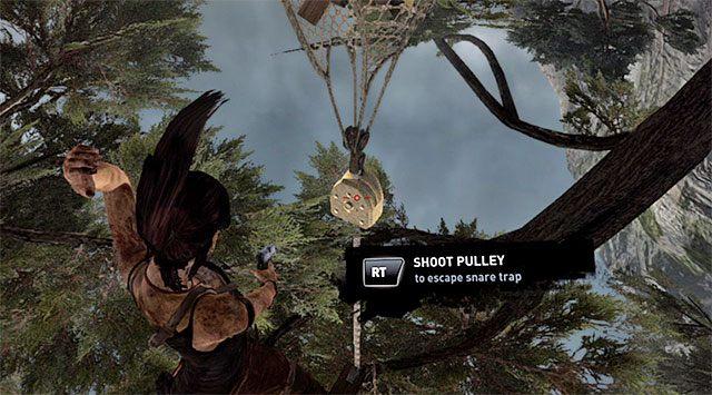 Po zlikwidowaniu wszystkich wrogów oddaj dodatkowy strzał w mechanizm pułapki, tak by Lara mogła się oswobodzić - Spotkaj się z Rothem - 9 - Rzadziej uczęszczana ścieżka - Tomb Raider - poradnik do gry