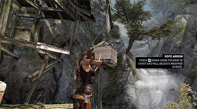 W celu odblokowania sobie przejścia do kolejnej lokacji musisz wystrzelić strzałę połączoną z liną w stronę pokazanego na dołączonym screenie ładunku zawieszonego na dźwigu - Spotkaj się z Rothem - 9 - Rzadziej uczęszczana ścieżka - Tomb Raider - poradnik do gry
