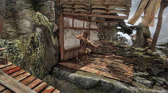 To jeszcze nie koniec, bo w celu uniknięcia śmierci w dramatycznych okolicznościach musisz szybko przeskoczyć na sąsiednią półkę (nagroda: 500 punktów doświadczenia) - Rozpal ognisko, by nadać sygnał wezwania pomocy - 8 - Wołanie o pomoc - Tomb Raider - poradnik do gry