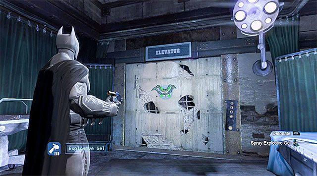 Po zakończonej bitwie skieruj się w stronę zachodniego przejścia, wciskając przycisk i docierając do izby chorych [Infirmary] - Zabierz zakłócacz z magazynu dowodów - Główny wątek - Batman: Arkham Origins - poradnik do gry