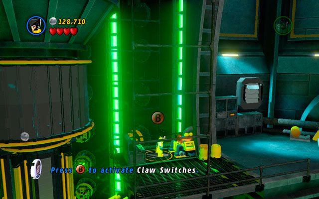 Na następnej kładce pokonaj przeciwników, po czym wyważ ścianę z zielonymi uchwytami - Taking Liberties - Opis przejścia - LEGO Marvel Super Heroes - poradnik do gry