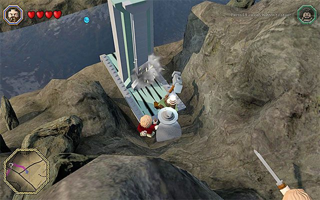 Musisz popchnąć blok z użyciem młota Dwalina - Śródziemie - Dotarcie do Siedzib Trolli | Opis przejścia - LEGO The Hobbit - poradnik do gry