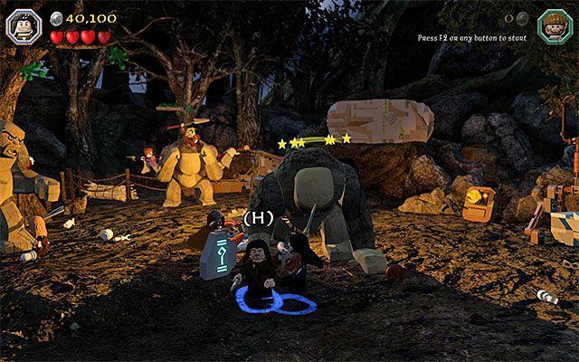 Podejdź do krasnoluda i zdecyduj się na atak w kooperacji - Etap 4 (Roast Mutton) - Bitwa z trollami | Opis przejścia - LEGO The Hobbit - poradnik do gry