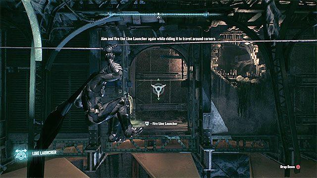 Trafienie zdalnym batarangiem w przycisk odblokuje boczne przejście i musisz się tam od razu przemieścić z wykorzystaniem wyrzutni lin - Zinfiltrowanie sieci tuneli pod wyspą Miagani - Główny wątek fabularny - Batman: Arkham Knight - opis przejścia