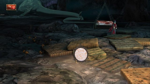 Gdy smok zacznie pałaszować stek, czym prędzej jeszcze raz przekręcamy kołowrotek, a potem wskakujemy na platformę z mięsem - Legowisko smoka - Magiczne lustro - Kings Quest - poradnik do gry