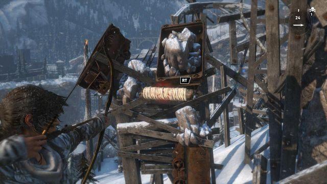 Pozbądź się blokującego możliwość skoku dalej wózka wystrzeliwując kolejną strzałę z liną - Dotrzyj do wejścia do kopalni   Znów sama - Rise of the Tomb Raider - poradnik do gry