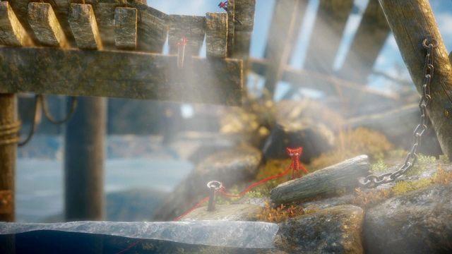 Używając kolejnych pętli przedostań się nad zbiornikiem wodnym uważając na przypływy - Poziom 2 - The Sea - Opis przejścia - Unravel - poradnik do gry