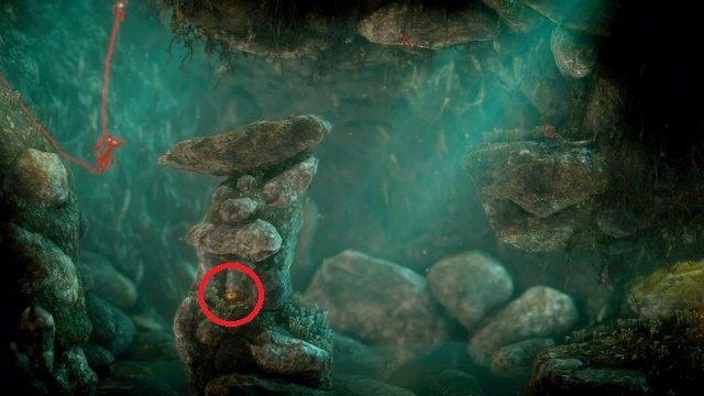 Wewnątrz jaskini przy pierwszej rozpadlinie opuść się nieco w dół - dostrzeżesz tam pierwszy guzik - Poziom 4 - Mountain Trek - Opis przejścia - Unravel - poradnik do gry