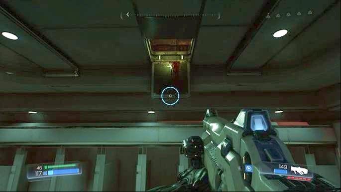Jak wyjdziesz z pokoju, będziesz mijał święcące na czerwono drzwi, za którymi znajduje się Automapa oraz Elitarny Strażnik - Kompleks Badań | Opis przejścia - Doom - poradnik do gry