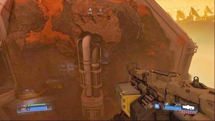 Aby się do niej dostać, wdrap się na szczyt stojącej po środku lokacji skały (znajdziesz tam pancerz) i skocz korzystając z podwójnego skoku - Kompleks Badań | Opis przejścia - Doom - poradnik do gry