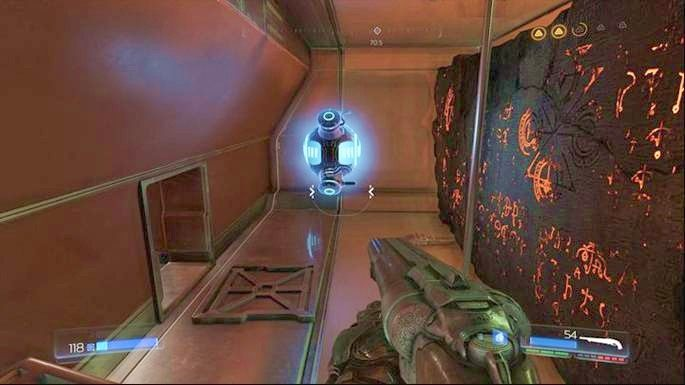 Za drugim artefaktem z lewej jest również Megazdrowie oraz tunel prowadzący do kolekcjonerskiej figurki (Pan Elita) - Laboratoria Lazarus | Opis przejścia - Doom - poradnik do gry