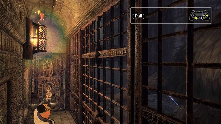 Skorzystanie z uchwytu pozwoli podnieść bramę i uwolnić Trico - Podniesienie bramy przygniatającej ogon Trico - The Last Guardian - poradnik do gry