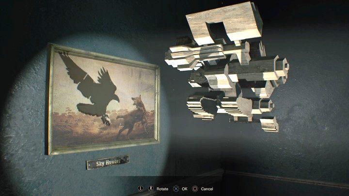 Podobnie jak na nagraniu, obróć figurkę, by cień pasował do pustego pola - Główny hall - Resident Evil VII: Biohazard - poradnik do gry
