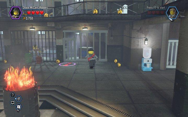 Możesz teraz używać łomu do wyważania niektórych drzwi i krat - Cele więzienne na wyspie   Rozdział 3 - LEGO City: Tajny Agent - poradnik do gry