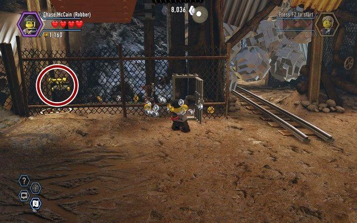 Użyj żółtej dźwigni za siatką, by otrzymać klocki na budowę skrzyni - Kopalnia   Rozdział 3 - LEGO City: Tajny Agent - poradnik do gry