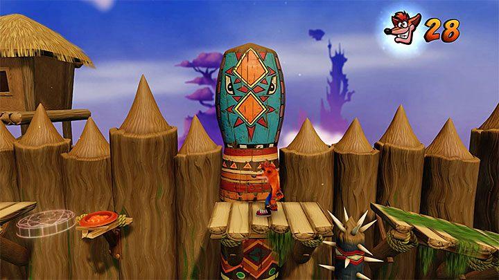 W pokazanym na obrazku miejscu należy umieścić czerwony klejnot i dla przypomnienia ten sekretny obiekt możesz odblokować dzięki perfekcyjnemu (czyli bez zgonów i niszcząc wszystkie skrzynie) zaliczeniu etapu Slippery Climb z dalszej części gry - Native Fortress | Crash Bandicoot - N. Sanity Island - Crash Bandicoot N. Sane Trilogy - poradnik do gry