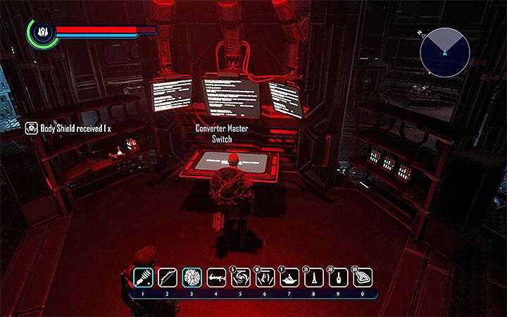 Po wygraniu pojedynku z dowódcą (300XP) odszukaj pokazaną na obrazku dużą czerwoną konsolę sterowania - Zadania w krainie Tavar | Tavar | Zadania poboczne - Elex - poradnik do gry