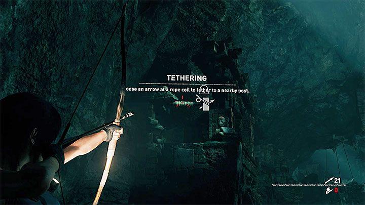 Ustaw się przy słupie ze zwojem lin i wyceluj w widoczny w oddali kolejny zwój lin - pokazuje go powyższy obrazek - Zbadanie ruin świątyni w Cozumel - Solucja Shadow of the Tomb Raider - Shadow of the Tomb Raider - poradnik do gry