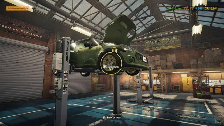 Поднятая машина обеспечивает доступ к передней и задней подвеске - Car Mechanic Simulator 2021: Замена деталей - Руководство по игре Car Mechanic Simulator 2021