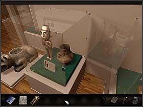 A zatem musisz wstawi� do gabloty co�, czego ci�ar zasugeruje czujnikom, �e figurka jest z powrotem na miejscu - Muzeum Sztuki Prekolumbijskiej - Dzie� 2 - Art of Murder: Sztuka Zbrodni - poradnik do gry