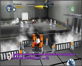 W dużej sali przełącz się na Antillesa i użyj dźwigu (patrz na cień wysięgnika), by z jego pomocą pozbyć się szturmowców w głębi ekranu - Chapter 1 - Secret Plans - Story Mode - Episode 4 - LEGO Star Wars: The Complete Saga - poradnik do gry