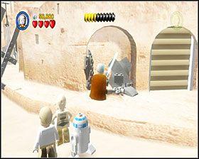 Gdy dojdziesz do sporego placu, będziesz musiał skompletować z porozrzucanych po okolicy klocków kompletnego AT-ST - Chapter 3 - Mos Eisley Spaceport - Story Mode - Episode 4 - LEGO Star Wars: The Complete Saga - poradnik do gry