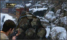 Po wskoczeniu na wagon z ciężarówką, załączy się krótka scenka, podczas której do akcji wkroczy silnie opancerzony oponent z ciężkim karabinem maszynowym - Rozdział 14 Światełko na końcu tunelu - Opis przejścia - Uncharted 2: Among Thieves - poradnik do gry