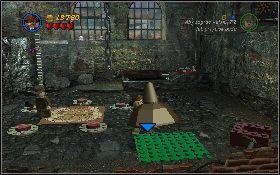 Następnie udaj się do ostatniego pomieszczenia z prawej i podnieś łopatę [1] leżącą z prawej strony kamiennego filaru - Mania muzyczna (bonus) - Kryształowa Czaszka Akt II - LEGO Indiana Jones 2: The Adventure Continues - poradnik do gry
